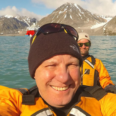 Neal Maxwell canoeing in The Arctic